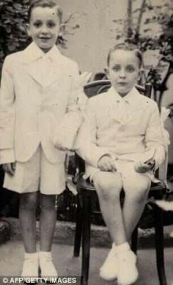 heyloveisallyouneed:  joecatholic:   Pope Francis (left) on his First Holy Communion day.   oh stop.