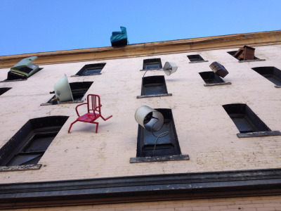weissaroni:  Defenestration, a public art installation of furniture being chucked out windows at 6th and Howard.