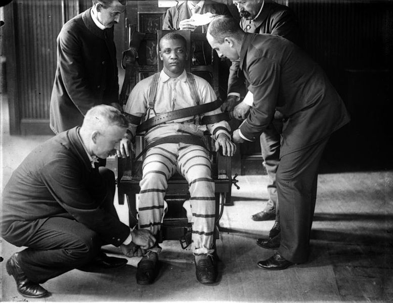Prisoner in the electric chair at Sing Sing Prison, circa 1900