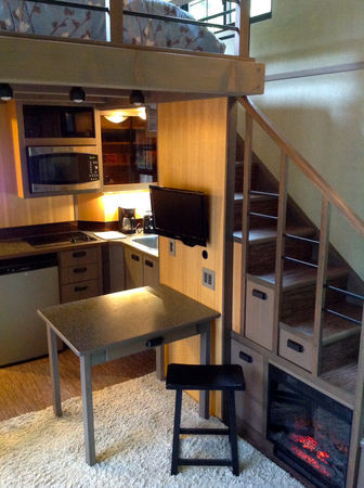 fuzzkvlt:  tinyhousedarling:  micromanor:  Hand Built Luxury Tiny House has Fireplace built into stairs and Jacuzzi Bath and Shower for sale.  Yes please!!  I need this.