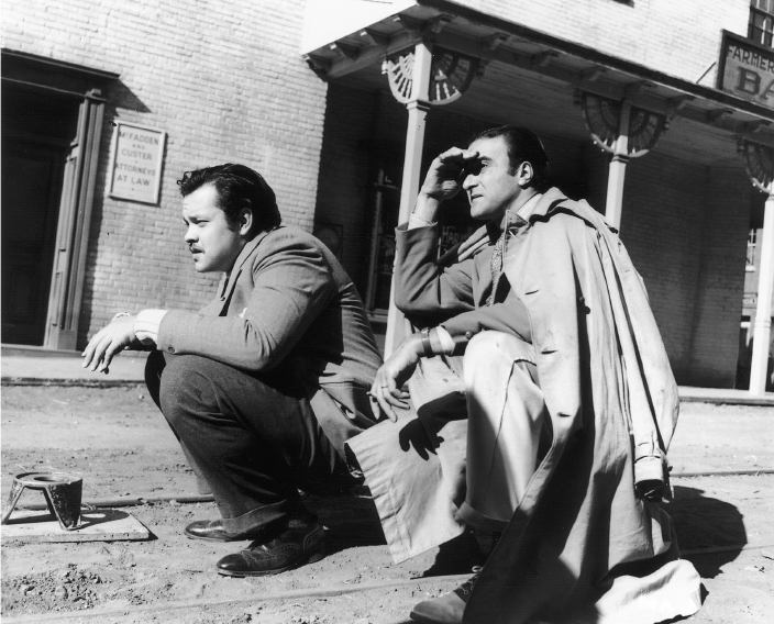 "Cinematographer Stanley Cortez (right) lines up a shot with director Orson Welles for The Magnificent Ambersons at the RKO ranch in 1942. Legendary cinematographer who shot, among other pictures, The Magnificent Ambersons, Since You Went Away, The Night of the Hunter and Shock Corridor.  Cinéma Cinémas — Stanley Cortez ASC — 1984  Let me give you the example of when I shot The Night of the Hunter for Charles Laughton. We did many films together with him as an actor before he asked me to do Hunter. We were shooting a particular sequence, and Laughton saw me doing a couple of things. ""What in hell are you doing, Cortez?"" he said. ""None of your goddamn business, Laughton,"" I said—in a very nice, lovable way, don't get me wrong. The respect was there. But he insisted that I tell him what I was doing. ""Charles, I'm thinking about a piece of music."" And in his particular way, he said to me, ""My God, Stan, how right you are. This sequence needs a waltz tempo."" And so he immediately sent for the composer Walter Schumann so he could see what I was doing visually, so he could interpret it into a waltz tempo. —Stanley Cortez, Conversations with the Great Moviemakers of Hollywood's Golden Age: At the American Film Institute    Watching the River: Mise en Scène and Safe Space in The Night of the Hunter Tweet  //  Follow @LaFamiliaFilm  //"