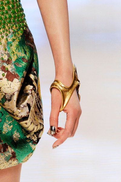 girlannachronism:  Alexander McQueen spring 2010 rtw details  Alexander McQueen designs some very strange things, but this statement cuff has to be one of my favorites.