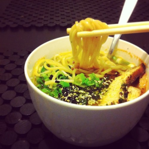 First homecooked meal of 2013: ramen! Veggie broth (salt, soba, soy sauce, pepper), seaweed nori, marinated tofu, green onions, and spinach #vegan #food #eatclean It is sooo cold in San Francisco (and probably everywhere else but Hawaii) right now, and nothing feels better than a hot bowl of noodles for dinner <3.  Ingredients: Organic Hakubaku Ramen Noodles Diced Green Onions Spinach Marinated Tofu (or BBQ pork to be traditional)  Vegetable Broth (chicken broth for omnivores)  Soy Sauce Soba Sauce Salt & Pepper Nori  Directions for 1 serving (~400 calories): Bring vegetable broth to a boil. Add 1 tsp soy sauce and 1 tblsp soba sauce. Add salt to taste. Let the broth simmer while you prepare the ramen noodles in rapidly boiling water (about 4 minutes). Chop onions and gather spinach. Heat tofu/protein. Drain noodles into a bowl. Pour the broth over the noodles. Add your toppings and season with pepper. Simple, yet satisfying.
