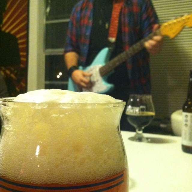 Good beer and good tunes makes one happy man