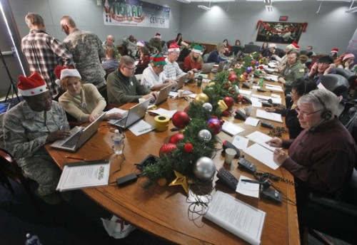 Inside NORAD's command center as Santa trackers follow Santa's progress (Photo: Brennan Linsley / AP) Over a thousand volunteers at NORAD handle more than 100,000 thousand phone calls from children around the world every Christmas Eve as NORAD charts Santa's progress around the globe.  Read the complete story.