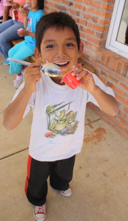 Thanks to our food sponsors, the kids are enjoying healthy snack time including fruit, yogurt and milk :)