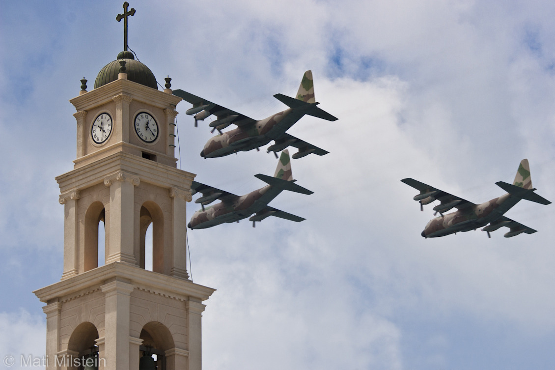 Free Fly Zone  Israeli air force planes fly over St. Peter's Church in the coastal city of Jaffa as the country marks its 65th Independence Day. In 1945, Jaffa had a population of 101,580, of whom 53,930 were Muslims, 30,820 were Jews and 16,800 were Christians. When Jewish forces occupied the city on 14 May, 1948, only 4,000 of the city's Muslim and Christian Palestinian residents remained.