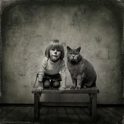 Little Girl and Tomcat by Andy Prokh An economist takes photos of his daughter and her cat.