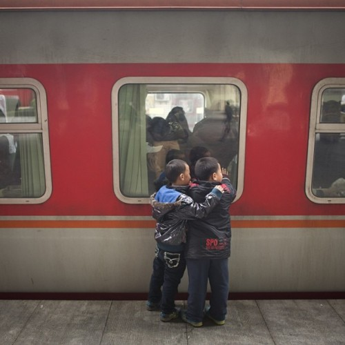 Two boys say good bye to their mom at the  Changsha train station in Changsha, China, January 12, 2013. (John Lehmann/The Globe and Mail) check out @johnlehmann for more from his trio to china. #china #mao #photojournalism