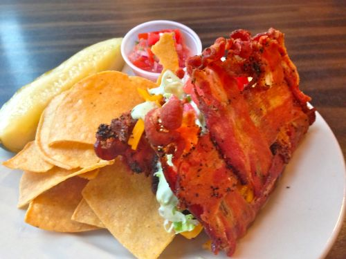 And the new burger of the week is the …BACON-SHELL BURGER TACO! We've actually created a taco shell out of 100% bacon. And filled this crispy beauty with a taco seasoned beef burger, shredded cheddar & pepper jack cheese, shredded lettuce, fresh pico de gallo and an avocado & cilantro ranch sauce. Served with house made tortilla chips and salsa.  Available NOW is very limited supplies! (The bacon-shell tacos are very time consuming to make, and we are limiting them to 20 orders per day…so first come, first serve)