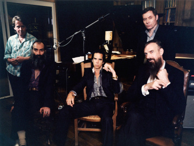 nprmusic:  The Australian singer and writer Nick Cave assembles a string of slow-burning ballads that seethe and surprise, punctuated by Warren Ellis' gorgeous strings and bits of Cave's own grabby, pervy innuendo. Stream Push the Sky Away now.  Photo: Cat Stevens  So long, whatever other stuff I was going to listen to today.