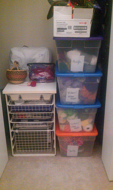Flipped stash yarn bins on Flickr. This is a pic of my closet in my yarn studio - I flipped my stash so that I could be looking at new and fresh things and spark off my brain juices, and organized my stash at the same time. WEE!