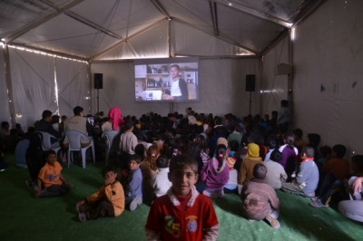 "An estimated 140,000 Syrians now live in the Zaatari refugee camp on the Jordan-Syria border. Mercy Corps' Lisa Hoashi recently visited the camp, and provides some insight into what everyday life is like there through this photo essay. The photo above is a ""cinema tent"" set up by Mercy Corps and Unicef, which plays kid-friendly movies every day. See more photos inside the Zaatari refugee camp."