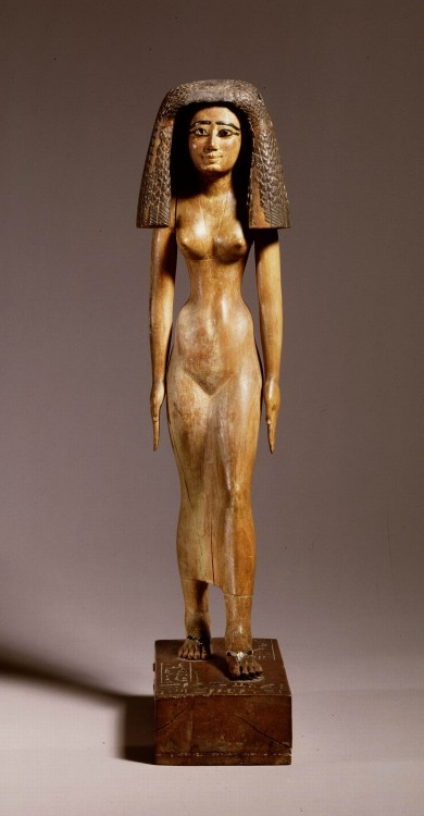 "ancientpeoples:  Wooden grave statue of priestess Imertnebes Middle Kingdom, 12th dynasty, 1991 - 1783 BC  Inscription : ""Gods hand and wife"", so priestess of the god Amun. She is wearing a skin tight dress and the wig was added later.  (Source: The Leiden Museum of Antiquities)"