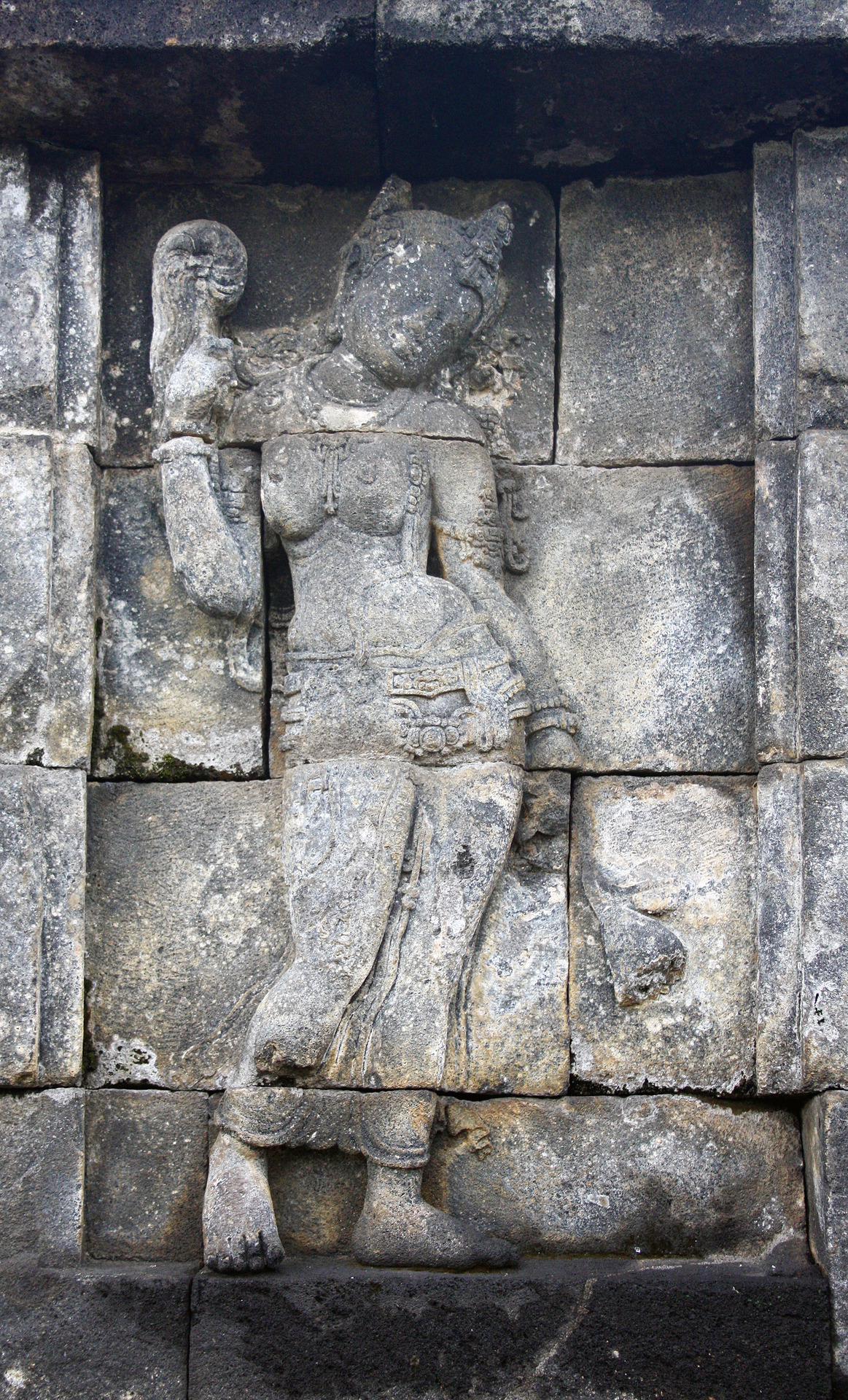 Devata with chamara (fly whisk), Borobudur, Java
