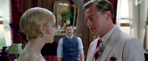 "Scenes from The Great Gatsby.      I'm not surprised that The Great Gatsby purists and fans of the original comic book/source material are angry at director Baz Luhrmann about the new film adaption's surprising twist where Leonardo DiCaprio actually plays an actor, Trevor Slattery, portraying the fictionalized character of Jay Gatsby within film and how narrator Nick Carraway (played by Tobey MacGuire) is revealed to be ""the real Gatsby"" behind the scenes."