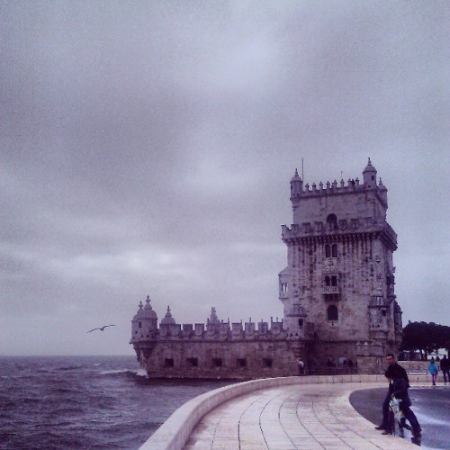torre de belém, a beautiful, huge watchtower overlooking the tagus river. the weather was dismal, the waters were choppy, my feet got soaked crossing the bridge, climbed the narrowest winding stairs ever to get to the top. it was awesome.