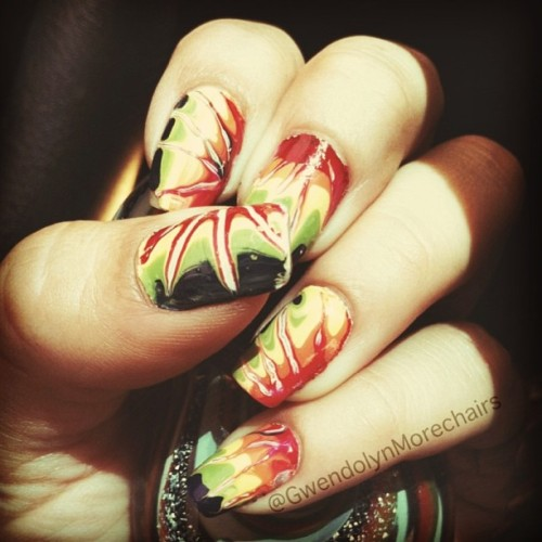 💅#Tiedyenails for the week. Super simple to do! 1.Paint your nails white. Let them dry. 2. Start with your colors painting them side by side quickly one by one (Make sure to glob it on) 3.Grab a toothpick or your stylus and lightly streak out from a point on the nail. 5. Add your clear top coat and your done! Enjoy and have a great week full of color. 🍄❤💗💛💚💙💜🌼