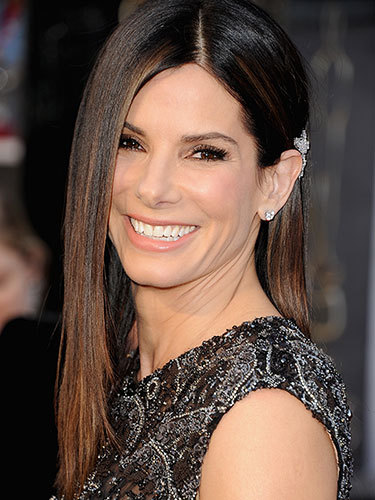 We LOVE Sandra Bullock's hair here! She glammed up her 'do with an elegant diamond hair clip tucked behind one ear. Classy!