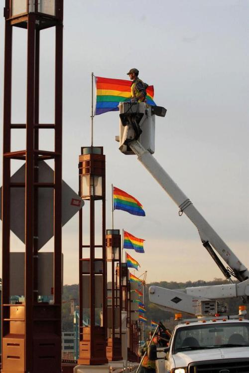 ackb:  lovelyredpanda:  St. Paul Public Works installing rainbow flags on the Wabasha Bridge this morning - thank you St. Paul and Mayor Coleman! (source)  Crying