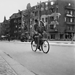 semioticapocalypse:  Fritz Eschen. Couple riding a bicycle in postwar Berlin, 1947. [::SemAp::]
