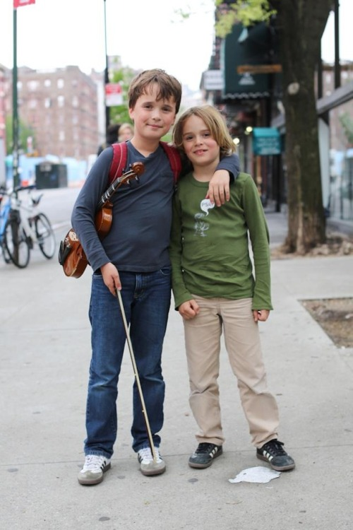 "humansofnewyork:  I photographed the little guy on the left because he was carrying a violin. During the post photo interview, his little brother kept chiming in with his own answers. It was clear that he wanted to be part of the process. After a few questions, the older one called to his brother: ""Come be in my picture, Riley."""
