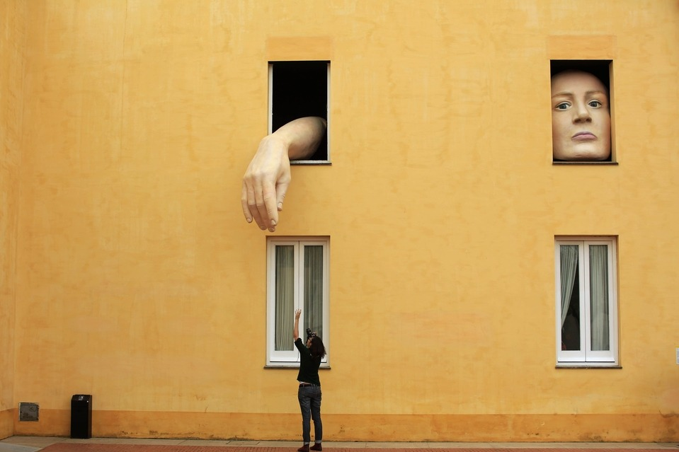 paxmachina:  HAND TO HAND:  A woman took pictures of the art installation 'Alice,' by Spanish artist Cristina Lucas, at a contemporary-art center in Seville, Spain, Wednesday. (Marcelo del Pozo/Reuters)