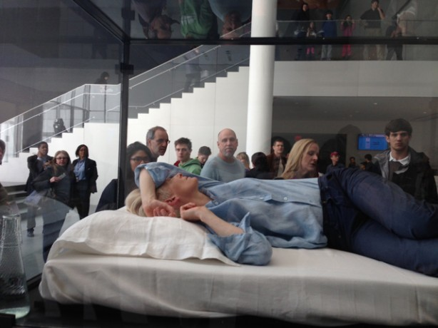 "Happening Now - Tilda Swinton seen sleeping a in a box at the Museum of Modern Art - Credit:Gothamist""Tilda Swinton will be doing unannounced, random performance art pieces sleeping in a glass box in the museum,"" the source added. ""Today is the first performance. Each performance lasts the whole day the museum is open."" Swinton and her box are located near the ticket collectors today, but the box may be in different locations at other performances.""http://gothamist.com/2013/03/23/photos_tilda_swinton_is_sleeping_in.php"