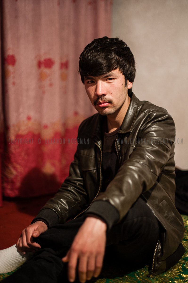 A young Uyghur man poses for the camera after afternoon chai in Kashgar.