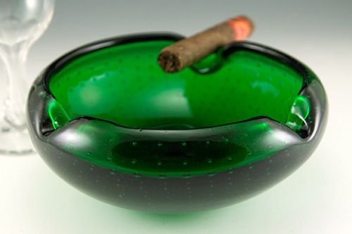 "Luxurious mid-20th Century cigar ashtray made with quality green crystal. Rich emerald green hand-blown colored lead crystal ashtray bowl with concentric bubbles. Quality lead crystal is very reflective and it is hard to image because it picks up the white of the shoot tent.  Without the reflections, this big ash bowl clearly shows the concentric trapped air-bubbles.  The bubbles are actually visible everywhere on the ashtray. Hand-made with polished pontil mark on the base.  Probably made in Italy or Scandinavia, circa 1950s - 1960s.  Made by a skilled glass artist. Beautiful.  Worthy of the finest cigars.  Measures 8½"" round and 3½"" tall.  Nice deep bowl with inverted rims.  Big Ashtray…weighs just under 4 lbs.  In perfect condition with light bottom-wear."
