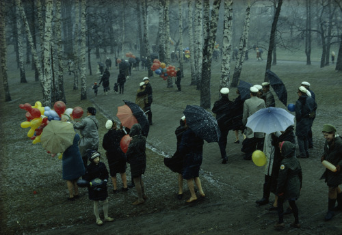 natgeofound:  People strolling through a park Finland during a wet May snowstorm, 1968.Photograph by George F. Mobley, National Geographic
