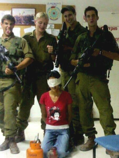 Israeli soldiers take a Palestinian girl, cuff her, blind-fold her, point their guns at her and take photos. === Zionist scum! This is some fascist shit … are we to think that this young girl was a threat to Israel's national security? I can only imagine in horror what transpired immediately before and after this photo was taken. There can be no peace for the righteous while Israel continues to carry out its unending crimes against humanity in Palestine.