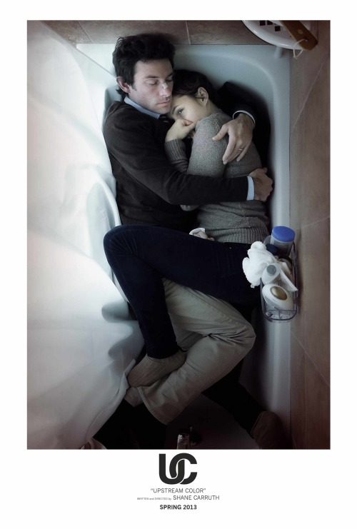 There was never any doubt that I would at least like UPSTREAM COLOR. I was a big Primer fan and all of the pre-release material looked intriguing to me. I saw it the first time when Shane Carruth was in town doing a few preview screenings with Q&A and that experience was great. Carruth's films can seem completely opaque at times, so seeing him as a very real person in the Q&A setting retroactively makes the film seem more relatable. I went to see UPSTREAM COLOR a second time yesterday and was able to finally confirm my love for it. I won't spoil anything or go into detail but the most amazing part of the experience was realizing how many pieces of the film had not been retained in my memory of seeing it the first time. Throughout the 96 minute run time I kept wondering if somehow I hadn't been shown a different cut, that maybe what I had mistakenly attended before was in fact a preview-screening which Carruth used to gather notes for further edits. But I knew that wasn't right. I was just scrambling for excuses as to why I seemed to be forgetting so much vital plot and character information from a movie I really enjoyed. I estimate that I retained 60%-75% of the film. Needless to say the forgotten 30% improved the movie greatly and I developed a theory for how I was able to forget so much. UPSTREAM COLOR relies almost entirely on visuals. Very few lines are spoken onscreen which means all the plot information is delivered to the audiences visually, making it effectively a silent film. I think audiences have the cognitive abilities to handle this, but what the through me off was seeing a story of this complexity told entirely through visuals.  Traditional silent films have very simple plots. Or scenes that are built out of a single goal that a character must accomplish, each scene or shot requires a point A to B progression that keeps audiences engaged like a trail of breadcrumbs. But imagine what a headache it would be to make a silent film version of something like The Matrix or Blade Runner. Both films tell large amounts of their story using incredible visual technique, but both rely heavily on a few long scenes of people talking in order to explain themselves or the world they live in. The information is being balanced between the audience's sense of sight and their sense of sound, alternating the experience, allowing us to relax one muscle while another is being exercised. All this to say, that UPSTREAM COLOR miraculously doesn't do that at all. Carruth manages to tell his complex narrative almost entirely through the visuals, which creates a very unique and wonderful experience but also one (in my case) that exhausted my ability to visually process and retain 100% of the information in the movie. So yeah, that second viewing really helped fill the gaps. And if this sounds interesting at all I encourage you to see the film (which should be out on DVD/BluRay this week) or you already saw it once, consider seeing it again.