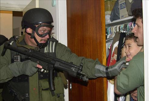 In an alternate universe the INS agent in this photo took litle Elian under his wing and they got into all kinds of hijinx together.  I believe our little Elian turns 21 this year.  I hope these two have reconciled their differences and they go out to have a drink together.  The laughs they'll have.  The laughs they'll have.