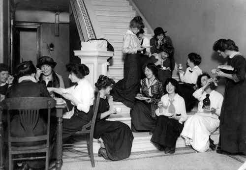 """Students eat lunch in the hallway of Fiske Hall, 1911."" (Barnard College Archives)"