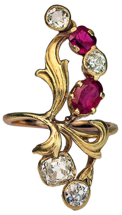 diamondsinthelibrary:  Art Nouveau ruby and diamond ring, circa 1900. This unique Art Nouveau ring is designed as a stylized spray of flowers with green gold chased leaves, set with diamonds and natural rubies.The diamonds are antique cushion cuts and old European cuts. Approximate weight (from bottom to top) - 0.35 ct, 0.80 ct, 0.25 ct, 0.28 ct. Total estimated diamond weight - 1.68 ct.Two natural rubies of good color - approximately 0.72 ct and 0.37 ct - 1.09 ct total weight. The ring was made in Moscow between 1899 and 1908. It is marked with 56 zolotnik gold standard (14K) with assayer's initials of Ivan Lebedkin. Via 1stdibs.