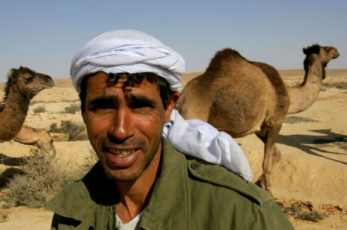 "Bedouin Arabs living in the Negev desert are being forced off their grazing lands into towns and villages that lack clean water, sanitation, electricity, and other basic services [GALLO/GETTY]   ""Today, the extremely difficult conditions prevalent in unrecognized Bedouin villages in the Negev is being used as an excuse to promote the urbanization of the Bedouin population. This effort comes despite the fact that the Bedouins have lived on their lands (considered state lands by the Israeli government) for generations, and despite the reality that the sub-par conditions in the townships mean that there is no real incentive for the Bedouins to leave their communities, despite being unrecognized.""  http://www.aljazeera.com/indepth/opinion/2011/06/20116238174269364.html"