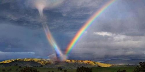 "you-are-another-me:  ""A friend took this pic in Arizona USA. The meteorologists don't have a name for it. Seems to be high energy to be in a Rainbow and a tornado! "" (source: Council of World Elders)"