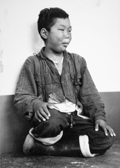 Unidentified Inuit boy at the Frobisher Bay Community Hall. Frobisher Bay, N.W.T., [Iqaluit (formerly Frobisher Bay), Nunavut], May 13, 1961. Credit: Charles Gimpel / Library and Archives Canada / e004665365 Restrictions on use: Nil Copyright: Copyright assigned to Library and Archives Canada by copyright owner Kay Gimpel. (via Description found in Archives - Search - Library and Archives Canada)