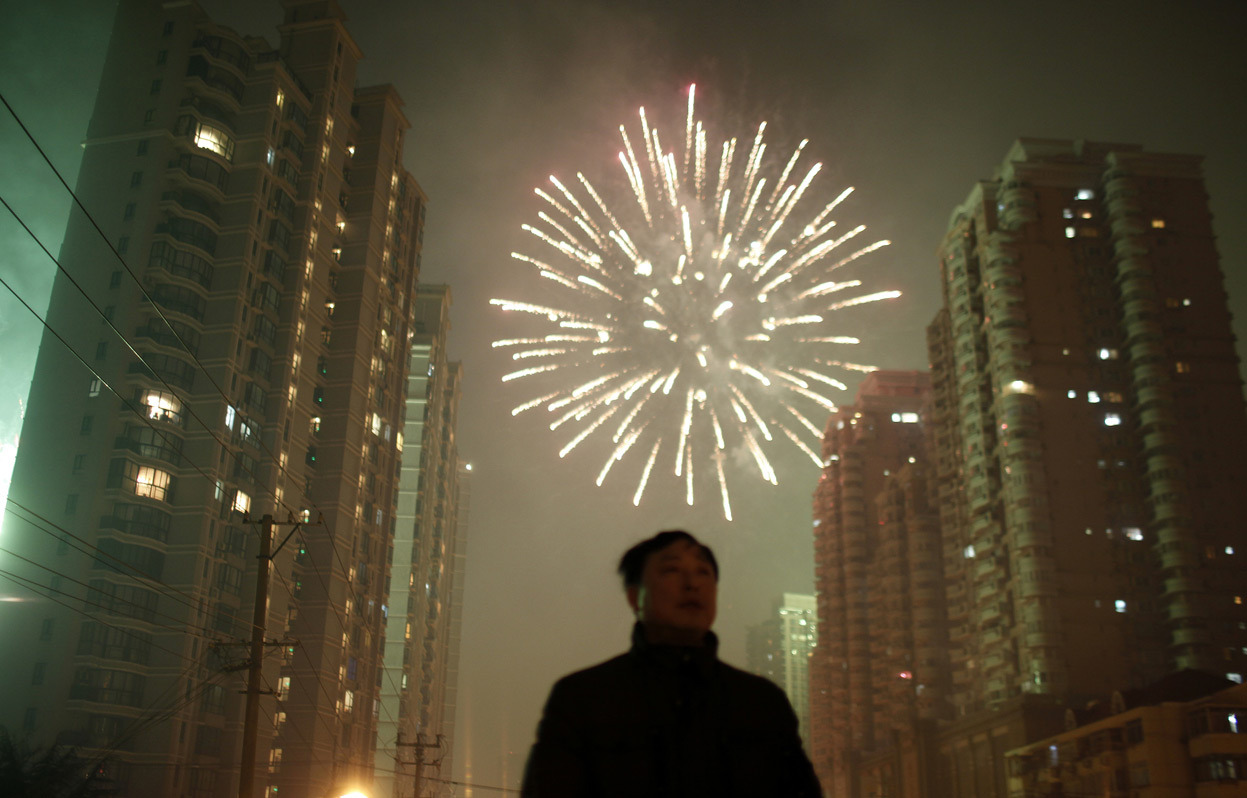 From Chinese Lunar New Year 2013, one of 29 photos. A man watches as fireworks light up the skyline of Shanghai in celebration of Chinese New Year in Shanghai, on February 10, 2013. The Lunar New Year, or Spring Festival, begins on February 10 and marks the start of the Year of the Snake, according to the Chinese zodiac. (Reuters/Carlos Barria)