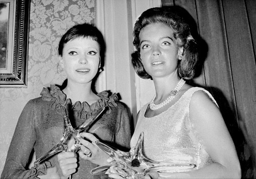 Anna Karina and Romy Schneider at L'Etoile de Cristal Awards, with their statuettes for Best Actress for Vivre Sa Vie and Best Supporting Actress for Le Procès, respectively; Paris, June 11, 1963.
