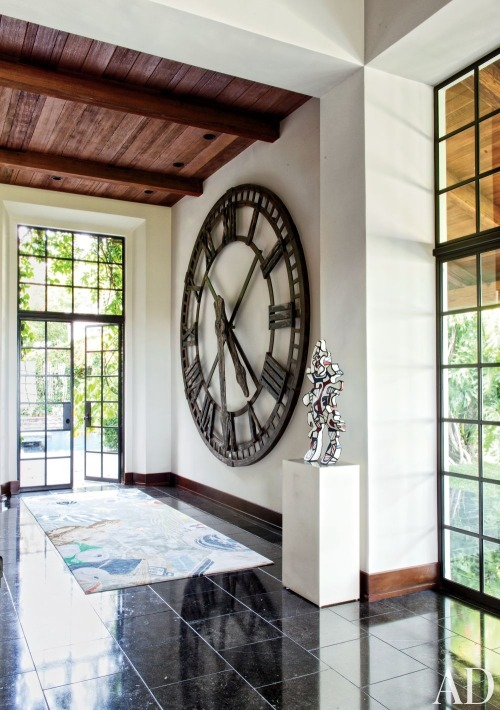 Modern Living Room by Nancy Heller  The bar area of a Los Angeles home showcases a vintage clock from Blackman Cruz and a sculpture by Jean Dubuffet.