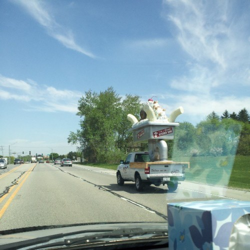 Why yes, I am driving next to giant banana split !