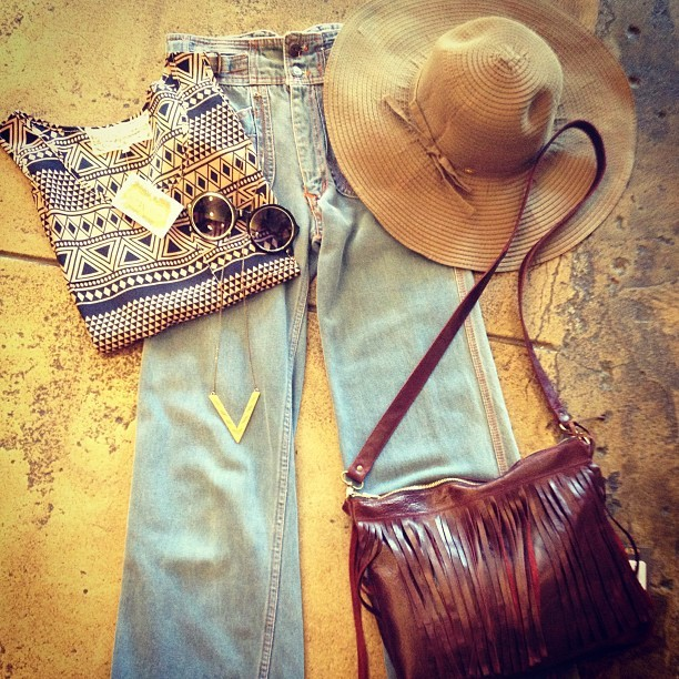 New cuteness at #unamaeslosangeles. #Pinkmartini Zulu tank $42, vintage denim $28, sandy ribbon hat $32, Vallente Leather burgundy fringe bag $98, #lovenailtree take aim necklace $44, and sunglasses $16. (at Una Mae's)