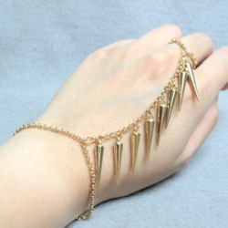 Moon Shine Apparel — Gold Spike Ring Bracelet on We Heart It - http://weheartit.com/entry/52046967/via/MoonShineApparel