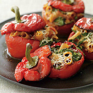 Daily Bite: Go meatless with these delicious Roasted-Pepper-Pasta-Stuffed Peppers. They're so filling you won't even notice that they're completely vegetarian!