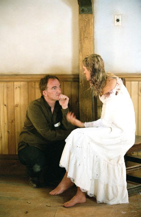 nearlyvintage:  Director Quentin Tarantino, Uma Thurman on-set, 2003