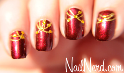 nailnerd-com:  Lightly decorated holiday nails with rhinestones on a base of Deborah Lippmann Through The Fire