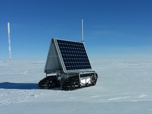 poptech:  If you are wandering around Greenland's ice sheet and you run into this crazy thing, it is NASA's GROVER (government acronym for something Goddard Remotely Operated Vehicle for Exploration and Research). It is solar powered and it crawls around Greenland on its own and uses ground-penetrating radar to look at ice. And it's cool.   NASA robot explores ice in Greenland. Video. Will explore for months at a time via remote. Possibly prototype to explore other planets.