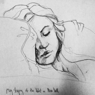 connerywrites:  My friend meg taking a nap on a couch at the hotel. We've got a few hours to kill before the bus ride home.
